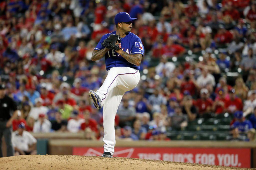 Texas Rangers' Matt Bush throws to the Toronto Blue Jays during a baseball game, Friday, May 13, 2016, in Arlington, Texas. (AP Photo/Tony Gutierrez)