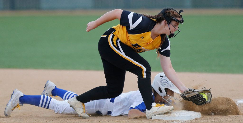 Plano West's Micayla Clark (9) is safe on pickoff attempt at first base as Plano East's Nikole High tries to apply the tag. Plano West won 3-2 in 10 innings.  (Stewart F. House/Special Contributor)