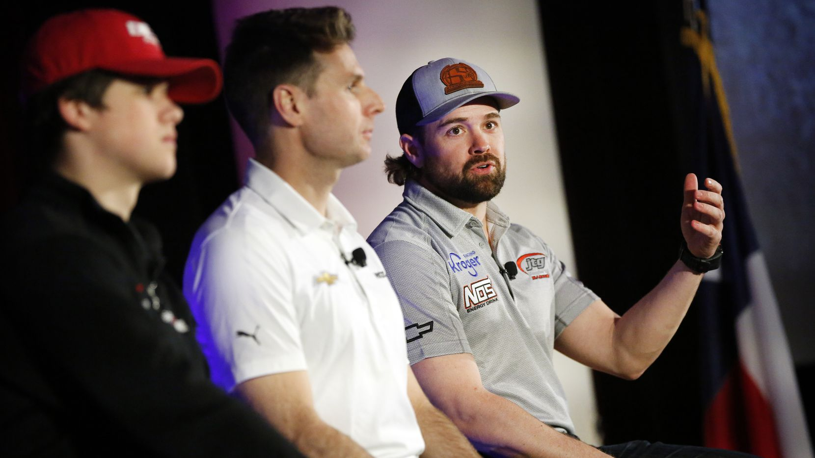 NASCAR Cup driver Ricky Stenhouse, Jr. (right)  answers questions about the upcoming race during Media Day at Texas Motor Speedway in Fort Worth, Wednesday, February 26, 2020. Seated next to him is IndyCar driver Will Power  and NASCAR Xfinity driver Harrison Burton (left).