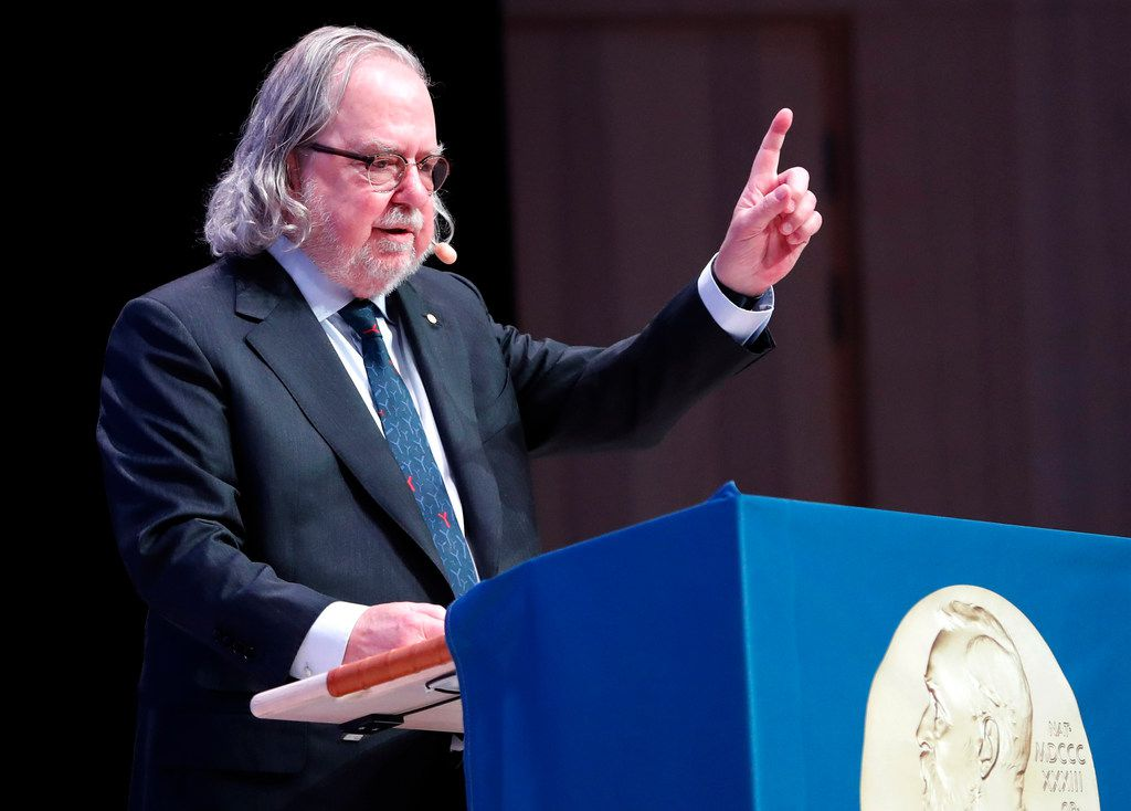 """The Nobel Prize laureate in Physiology or Medicine, James P. Allison, delivers his Nobel lecture """"Immune Checkpoint Blockade in Cancer Therapy: New Insights, Opportunities and Prospects for Cures"""" at Karolinska Institutet in Stockholm, on Dec. 7, 2018."""