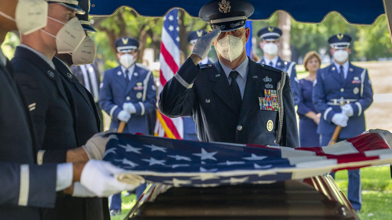 An Air Force Honor Guard member salutes during the funeral for Congressman Sam Johnson at the Restland Memorial Park in Dallas on Monday, June 8, 2020. In addition to 28 years of service as a congressional representative for Texas' 3rd District, Johnson was also a fighter pilot, decorated combat veteran and a former Prisoner of War.