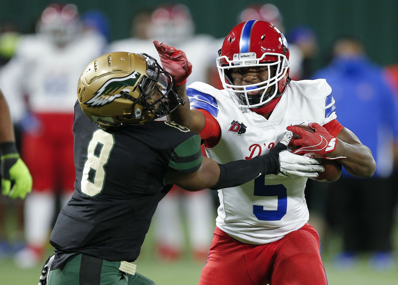 Duncanville junior running back Malachi Medlock (5) battle DeSoto senior safety D'verryon Foster (8) for yardage during the first half of a Class 6A Division I Region II final high school football game, Saturday, January 2, 2021. (Brandon Wade/Special Contributor)