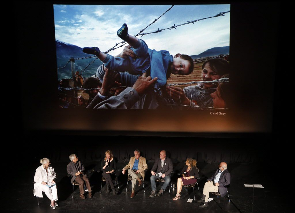 Four-time Pulitzer Prize winner Carol Guzy (third from left) discusses her winning work during the Illusion & Disillusion: A Conversation with Pulitzer-Winning Photographers panel discussion at the Texas Theatre in Oak Cliff, Wednesday, September 21, 2016. The panel moderated by Pulitzer winner Karen Blessen (left) featured five Pulitzer Prize-winning photographers including (starting second from left) Nick Ut, Carol Guzy, Bob Jackson, David Leeson, International WomenÕs Media Foundation's inaugural Anja Niedringhaus Award, Heidi Levine, and David Hume Kennerly. The event, in conjunction with the 100th anniversary of the Pulitzer Prizes, also had Pulitzer Prize-winning readings and performances. The evening was presented by The Sixth Floor Museum and 29 Pieces.