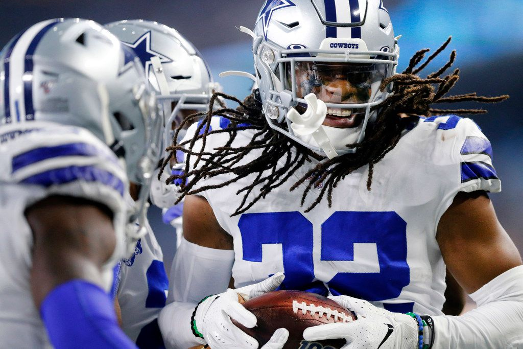 Dallas Cowboys cornerback Donovan Olumba (32) celebrates his pick-six after scooping up a Tampa Bay Buccaneers deflected pass and returning it for a touchdown during the first quarter of their preseason game at AT&T Stadium in Arlington, Texas, Thursday, August 29, 2019. (Tom Fox/The Dallas Morning News)