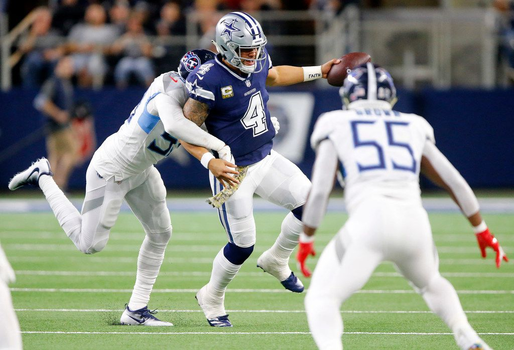Dallas Cowboys quarterback Dak Prescott (4) is chased down by Tennessee Titans inside linebacker Wesley Woodyard (59) in the second quarter at AT&T Stadium in Arlington, Texas Monday, November 5, 2018. (Tom Fox/The Dallas Morning News)