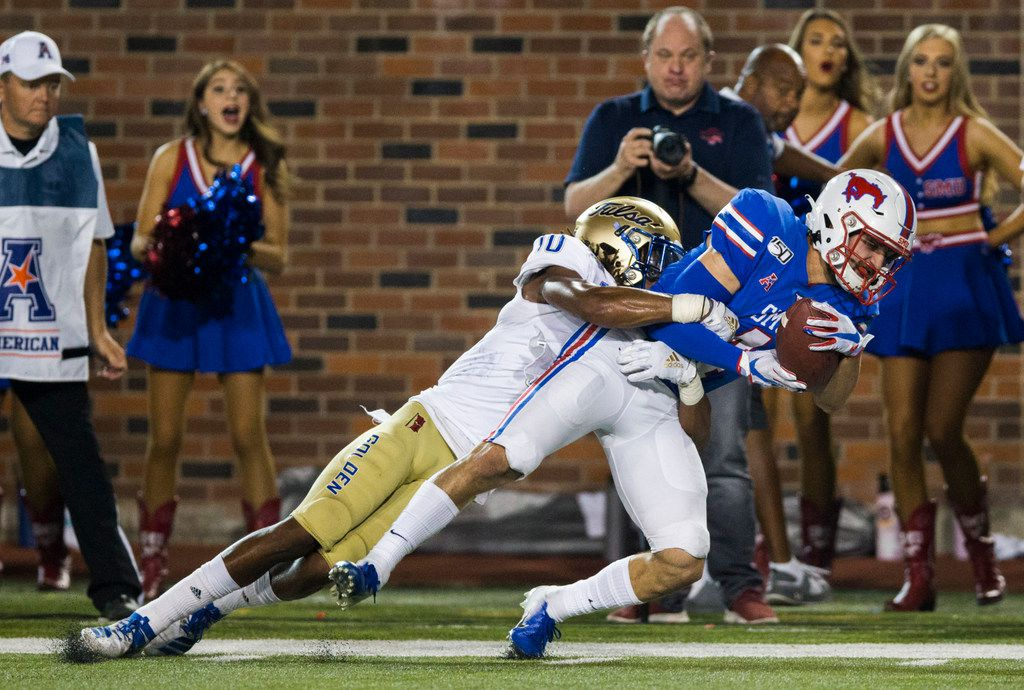 SMU Mustangs wide receiver Tyler Page (4) is tackled by Tulsa Golden Hurricane safety Manny Bunch (10) close the goal line during the third quarter of an NCAA football game between Tulsa and SMU on Saturday, October 5, 2019 at Ford Stadium on the SMU campus in Dallas. (Ashley Landis/The Dallas Morning News)