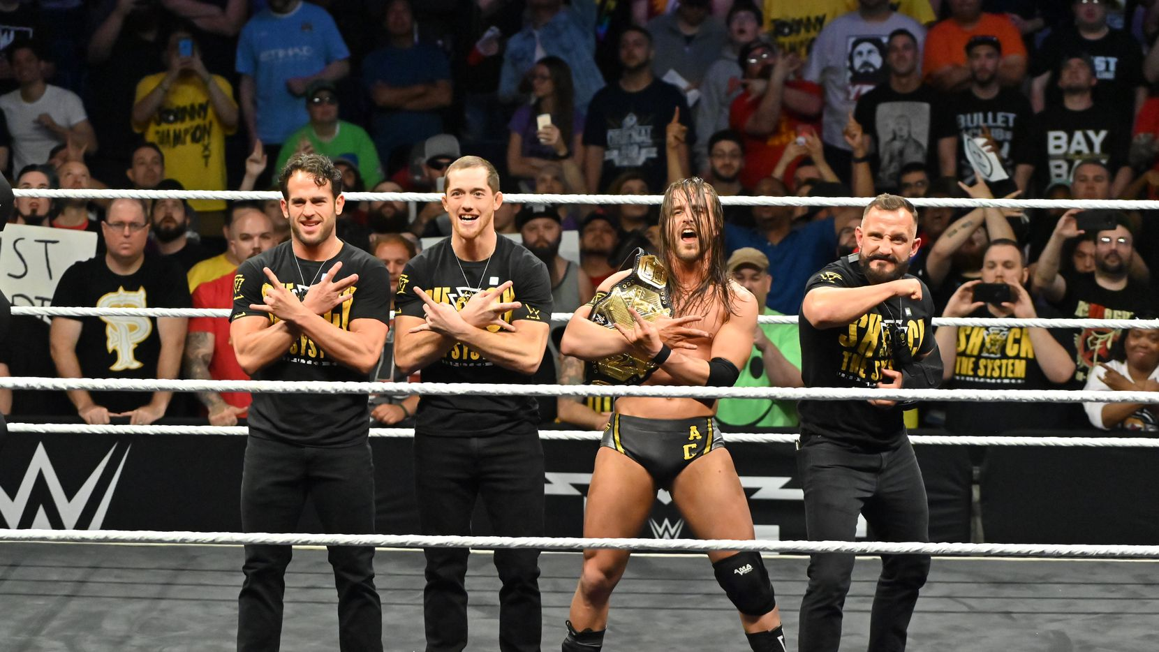 Adam Cole poses with the NXT championship alongside the Undisputed Era.