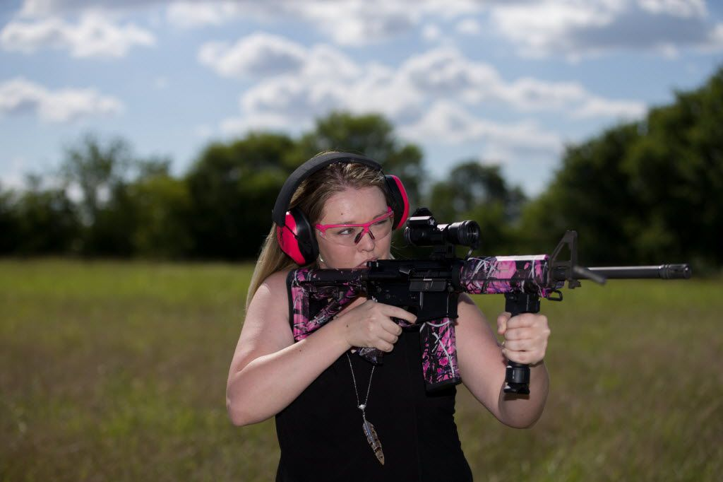 Daley Laurel of Blue Ridge, Texas shoots at a target with her Olympic Arms AR-15 with Moonshine Muddy Girl camouflage on June 24, 2016 in Dallas, Texas. (Ting Shen/The Dallas Morning News)
