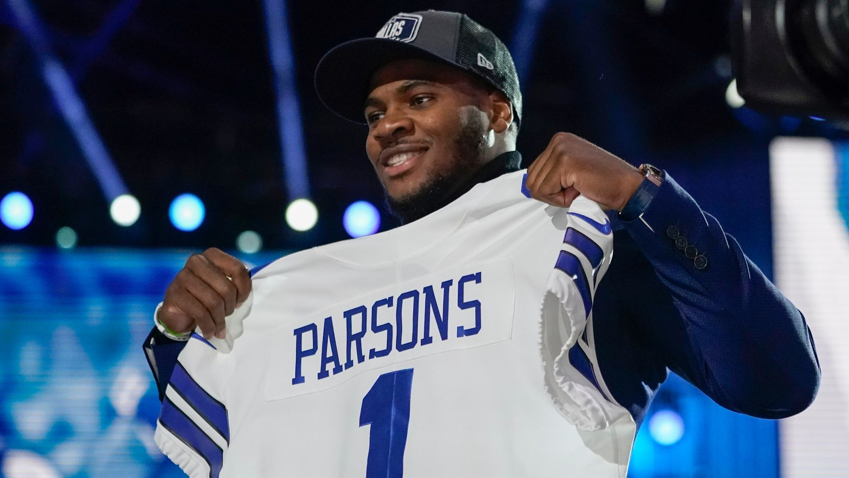 Penn State linebacker Micah Parsons holds a team jersey after the was chosen by the Dallas Cowboys with the 12th pick in the NFL football draft Thursday, April 29, 2021, in Cleveland.