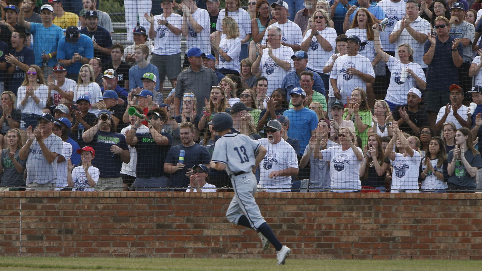 Northwest Eaton's Kolton Graham (13) dashes past the cheer of the fans after scoring in the top of a 3-run top of the 1st inning of play against Richland. Eaton won 6-2 to advance. The two teams played a one-game  Class 5A Region 1quarterfinal baseball playoff game at Hurst L.D. Bell High School on May 17, 2018. (Steve Hamm/ Special Contributor)