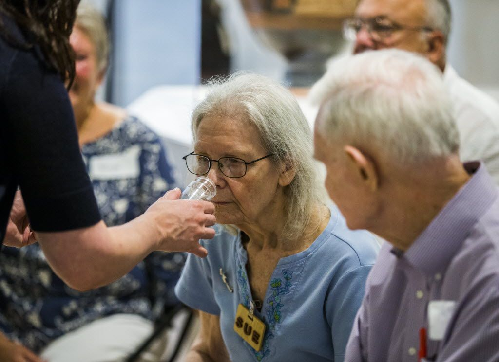 Sue Rath smells a sample scent of olive leaves as part of the Dallas Museum of Art's Meaningful Moments Program for individuals with early stages of dementia.