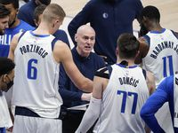 Dallas Mavericks head coach Rick Carlisle talks with center Kristaps Porzingis (6), guard Luka Doncic (77) and forward Tim Hardaway Jr. (11) during a time out in the second quarter of an NBA playoff basketball game against the LA Clippers at American Airlines Center on Sunday, May 30, 2021, in Dallas. (Smiley N. Pool/The Dallas Morning News)