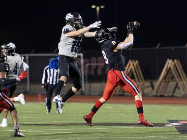 Senior defensive back Canon Peters (8) makes the game-sealing interception on a pass intended for Plano West senior wide receiver Jackson Stambaugh (15) as Coppell senior defensive back KJ Liggins (1) looks on in the fourth quarter of a high school football game on Friday, October 30, 2020 at Buddy Echols Field in Coppell, Texas. Coppell won 31-20.