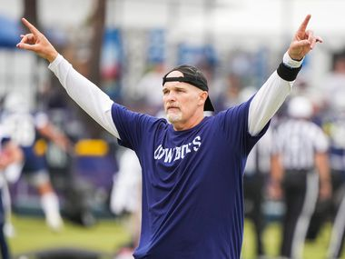 Dallas Cowboys defensive coordinator Dan Quinn motions to players during a practice at training camp on Saturday, July 24, 2021, in Oxnard, Calif.