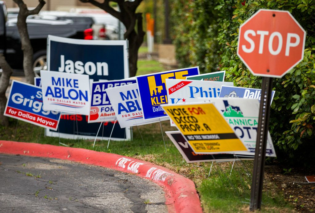 Campaign signs are displayed at the Dallas ISD Administration building, which is an early voting polling place, on Monday, April 29, 2019 in Dallas.