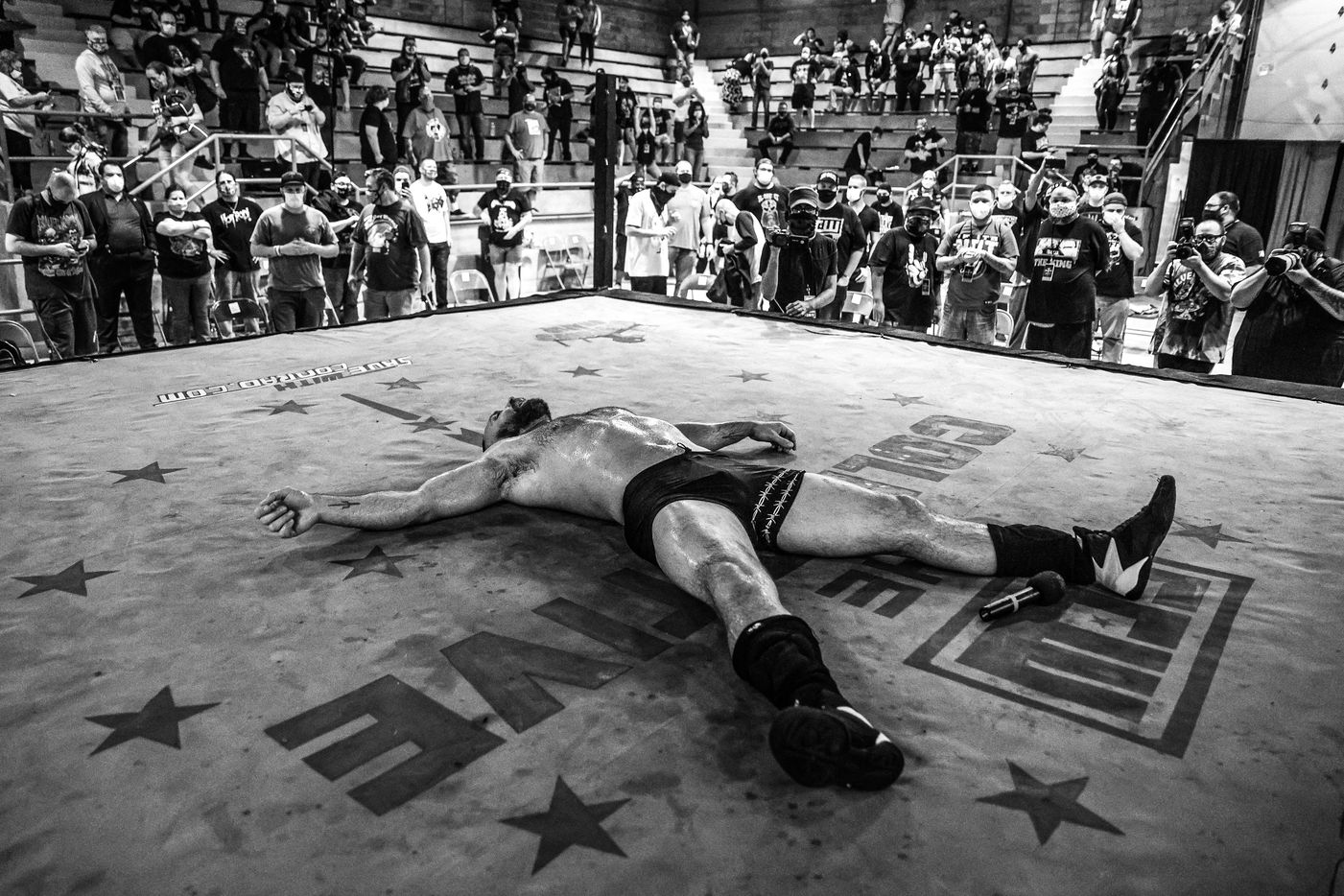 An exhausted Jon Moxley lies in the ring after his match at Game Changer Wrestling's Bloodsport on October 11, 2020. The portrait appears in the new, glossy art magazine about wrestling culture, Orange Crush, a passion project edited by art adviser and fan Adam Abdalla.