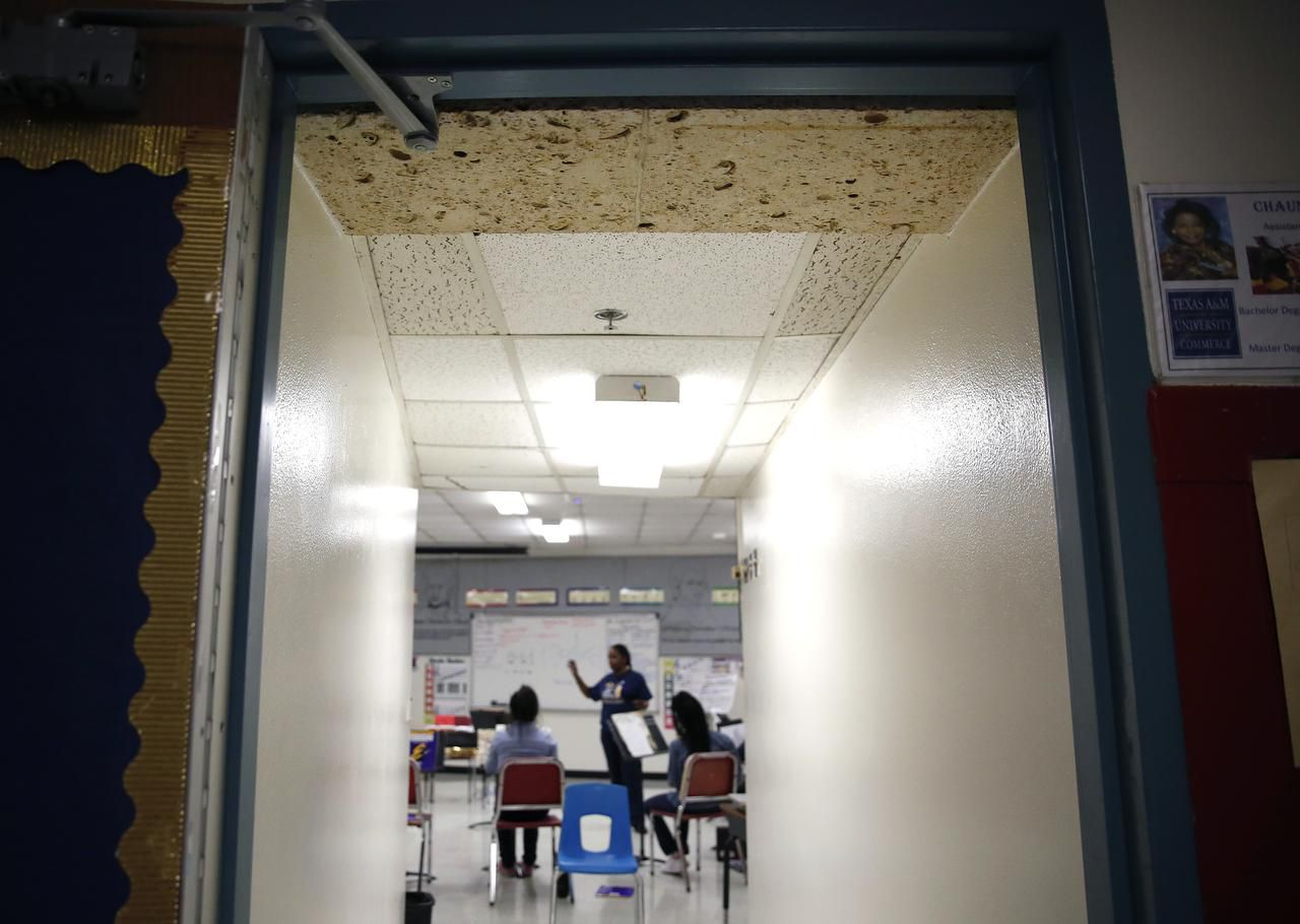 Mismatched ceiling tiles are seen in the band room at Thomas A. Edison Middle Learning Center in Dallas. A portion of DISD's bond would address repairs at schools.