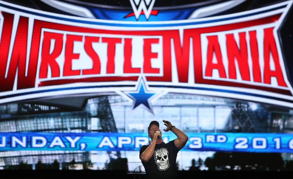 """Stone Cold"" Steve Austin cheers on fans at the start of events at the Wrestlemania On-Sale Party, that happened at AT&T Stadium in November 2015."