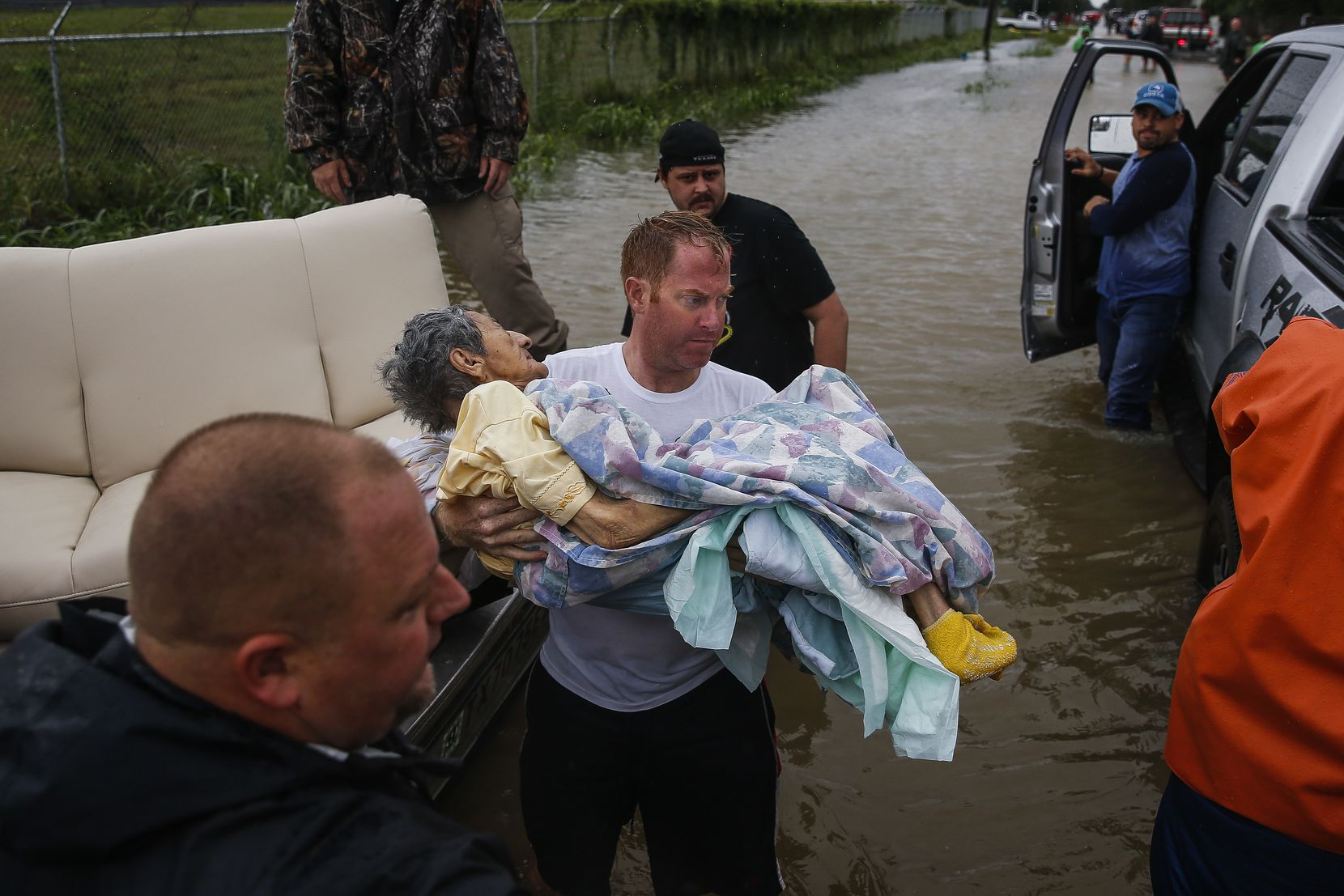 A rescuer moves Paulina Tamirano, 92, from a boat to a truck bed as people evacuate from the Savannah Estates neighborhood as Addicks Reservoir nears capacity Tuesday, Aug. 29, 2017 in Houston. ( Michael Ciaglo/Houston Chronicle via AP)