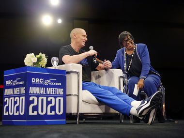 FILE - Mavericks CEO Cynt Marshall (right) laughs at head coach Rick Carlisle as they participated in a keynote conversation at the Dallas Regional Chamber's annual meeting and luncheon at the Hilton Anatole hotel in Dallas on Thursday, Jan. 9, 2020.