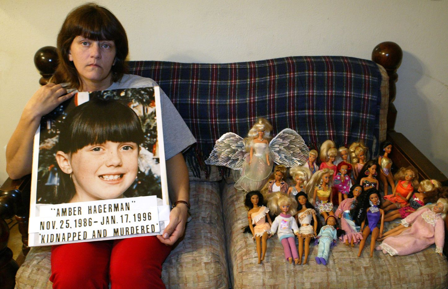 Donna Norris, mother of Amber Hagerman, sits next to her daughter's dolls while at her home in Hurst on January 10, 2006. Donna went to Washington, D.C. that week to commemorate the 10-year anniversary of her daughter's death. Amber was abducted and killed Jan. 13, 1996.