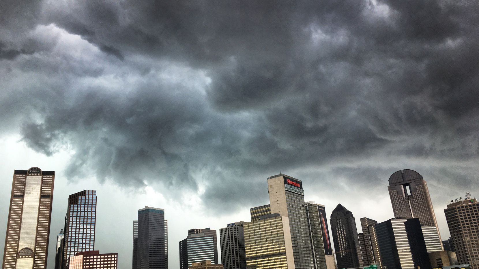 Ominous looking storm clouds roll over downtown Dallas, Monday afternoon, October 8, 2018. Dime-sized hail was reported with some of these storms that were moving south to north through Dallas, Collin and Denton counties. A slight risk of severe weather is expected on Tuesday. (Tom Fox/The Dallas Morning News)