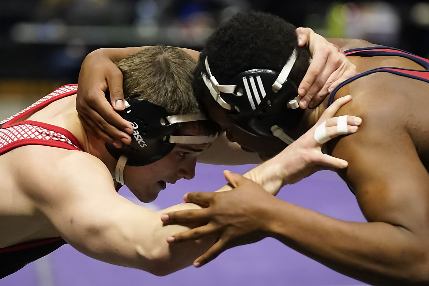Jakob Underwood of Lucas Lovejoy (left) wrestles John Bray of Frisco Centennial for the 5A boys 195-pound championship during the UIL State Wrestling tournament at the Berry Center on Friday, April 23, 2021, in Cypress, Texas. (Smiley N. Pool/The Dallas Morning News)