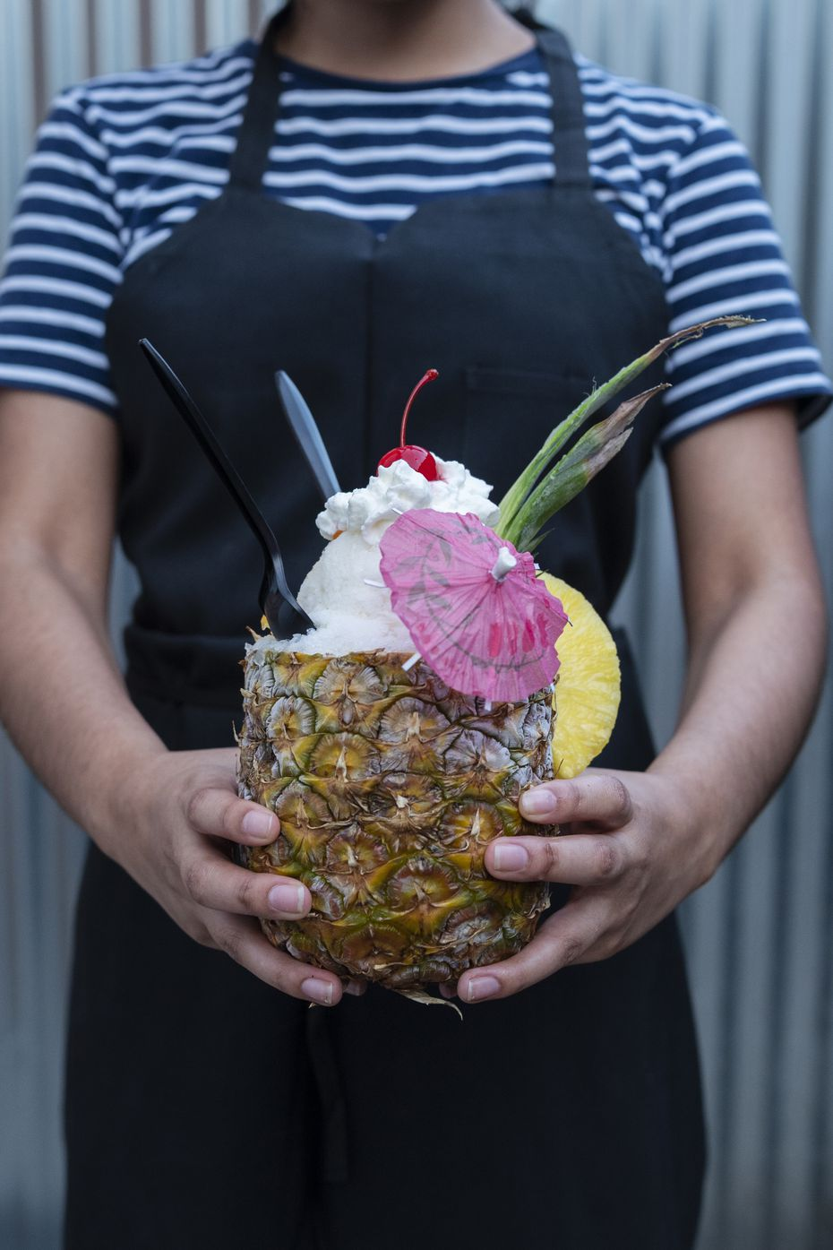 The pina alotta is made with house made pineapple and coconut syrup, whipped cream and vanilla ice cream, all served inside a pineapple. You have to admit, it's a good name.