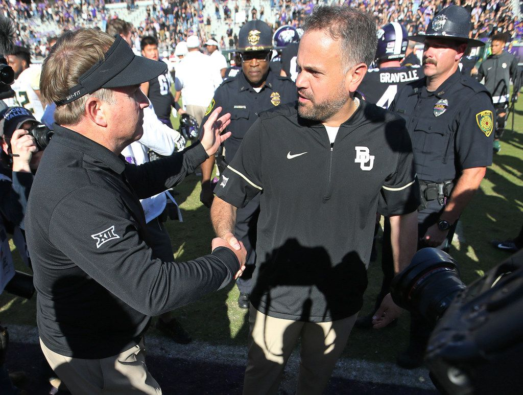 TCU head coach Gary Patterson shakes hands with Baylor head coach Matt Rhule after the Horned Frogs' 45-22 win during the Baylor University Bears vs. the TCU Horned Frogs NCAA college football game at Amon G. Carter Stadium in Fort Worth, Texas on Friday, November 24, 2017. (Louis DeLuca/The Dallas Morning News)