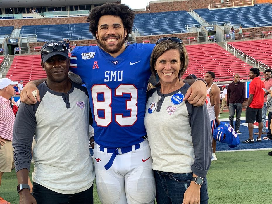 SMU tight end Kylen Granson (center) stands with his father, David Granson, and mother, Heather Granson, at Gerald J. Ford Stadium on the SMU campus.