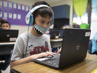 A student in Mesquite ISD participates in a classroom session on a computer.