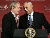 President Bush is greeted by former Secretary of State Colin Powell before making remarks at the Initiative for Global Development's 2006 National Summit in June 2006.