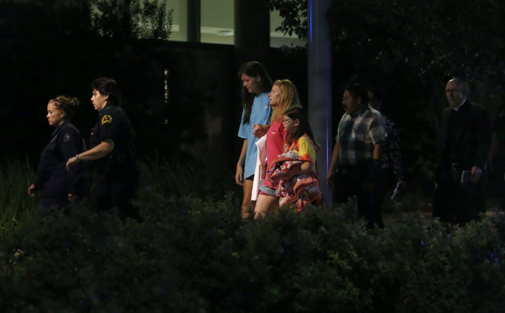 A family and reverend are escorted into a secured entrance by Dallas Police officers at Parkland Hospital in Dallas in the early morning of July 8, 2016 after shots were fired at a Black Lives Matter rally in downtown Dallas on Thursday, July 7, 2016. Dallas protestors rallied in the aftermath of the killing of Alton Sterling by police officers in Baton Rouge, La. and Philando Castile, who was killed by police less than 48 hours later in Minnesota. (Rose Baca/The Dallas Morning News)