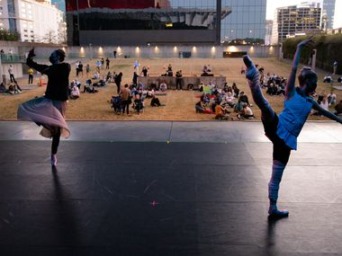Dancers with the Avant Chamber Ballet warm up before performing at the Annette Strauss Square in Dallas on Friday, March 26, 2021.
