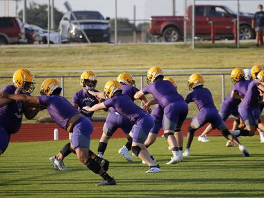 Linesmen run through a drill during the first day of high school football practice for 4A's Farmersville High School in Farmersville, Texas on Monday, August 3, 2020. (Vernon Bryant/The Dallas Morning News)