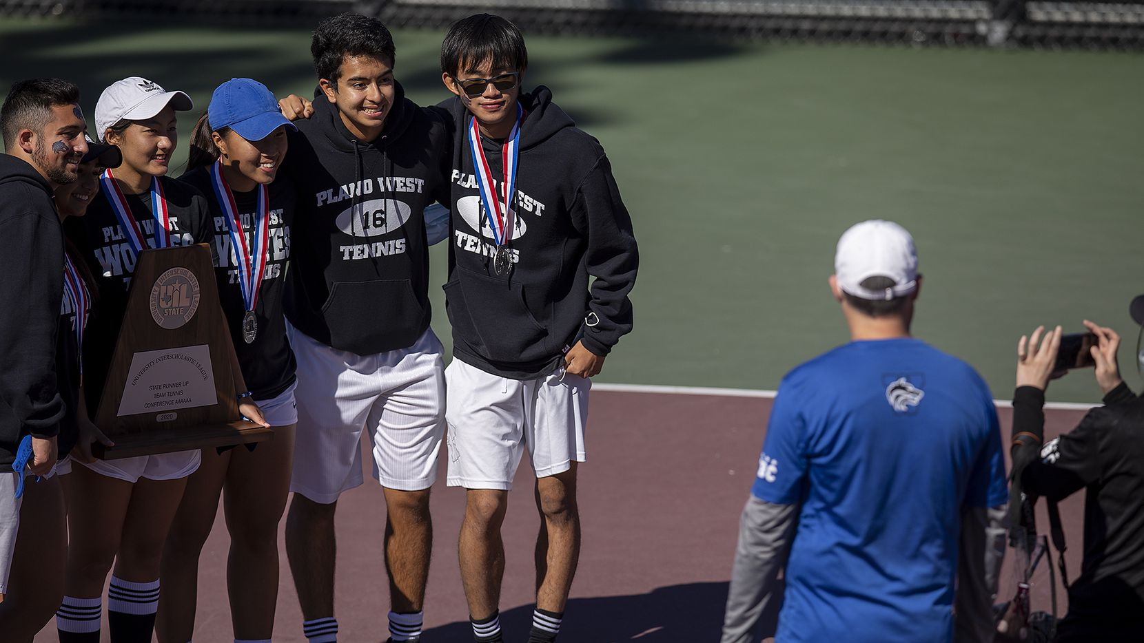 Plano West teammates take a picture with the runner-up trophy after losing the Class 6A team tennis state championship against Round Rock Westwood at Texas A&M's George P. Mitchell Tennis Center in College Station on Tuesday, Nov. 17, 2020.