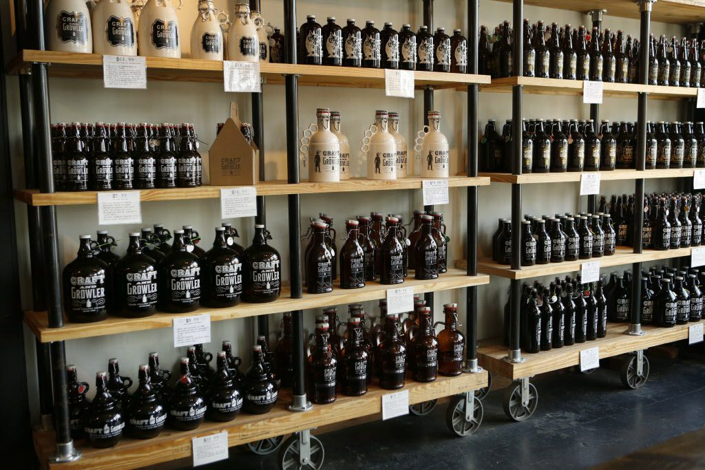 Growlers for sale at Craft & Growler, photographed September 26, 2014.