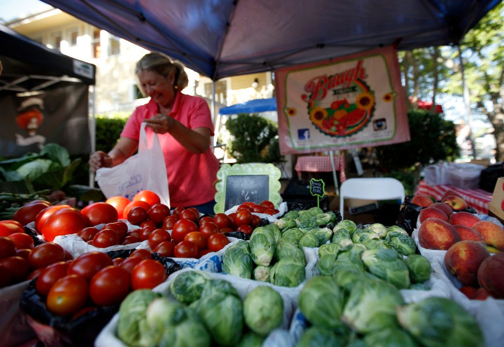 Marla Baugh of Baugh Farms bags tomatoes at the McKinney Farmer's Market in historic Chestnut Square in McKinney, Saturday, May 13, 2017. (Anja Schlein/Special Contributor)