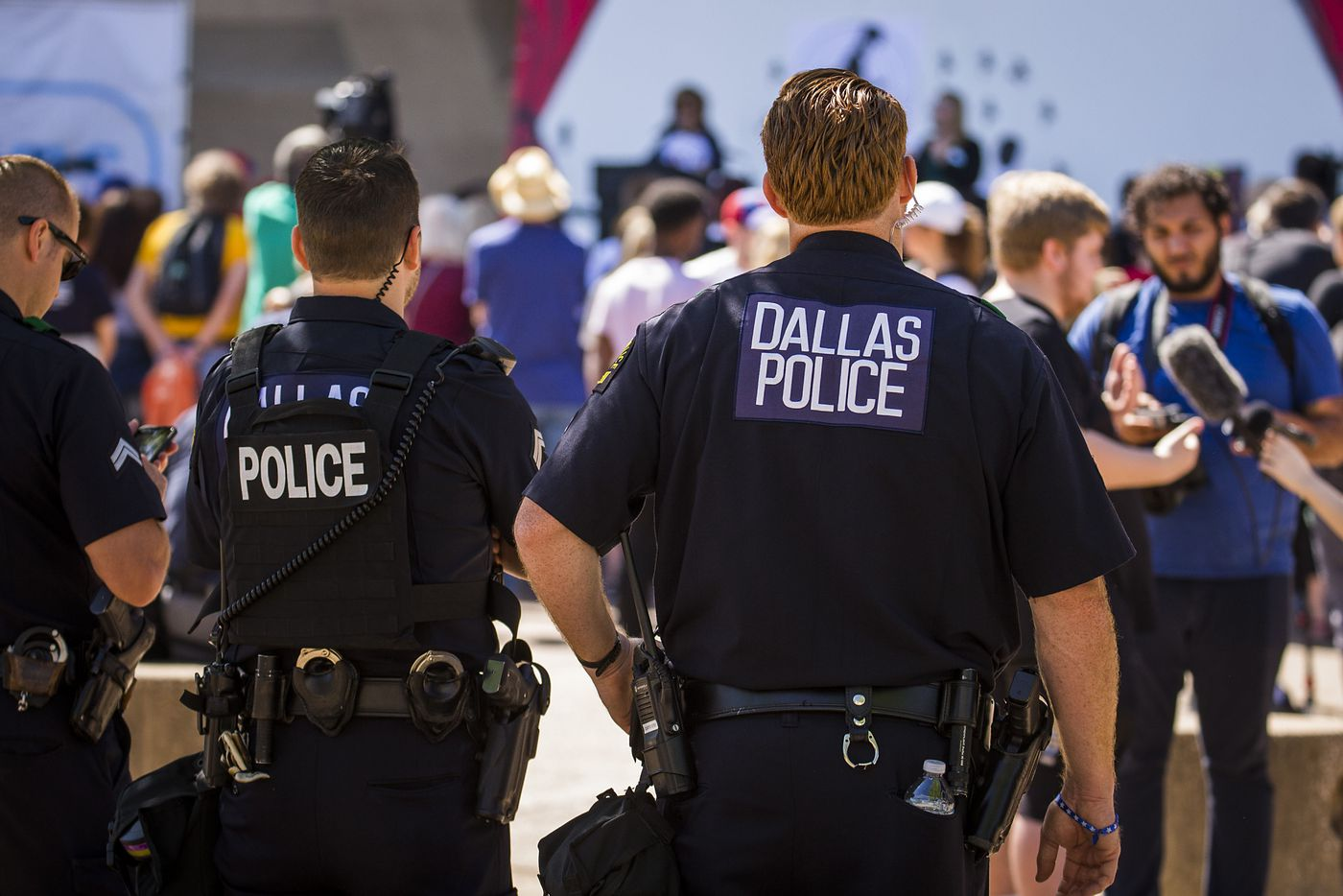 Dallas police keep an eye on control advocates as they demonstrate outside Dallas City Hall at a rally organized by StudentsMarch.org during the NRA Annual Meeting & Exhibits at the Kay Bailey Hutchison Convention Center on Saturday, May 5, 2018, in Dallas. (Smiley N. Pool/The Dallas Morning News)