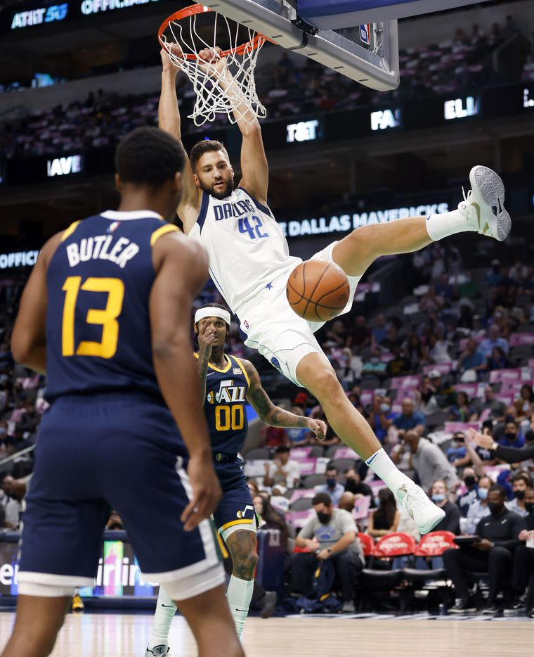 Dallas Mavericks forward Maxi Kleber (42) follows through on a first half alley-oop from Luka Doncic against the Utah Jazz at the American Airlines Center in Dallas, Wednesday, October 6, 2021.(Tom Fox/The Dallas Morning News)