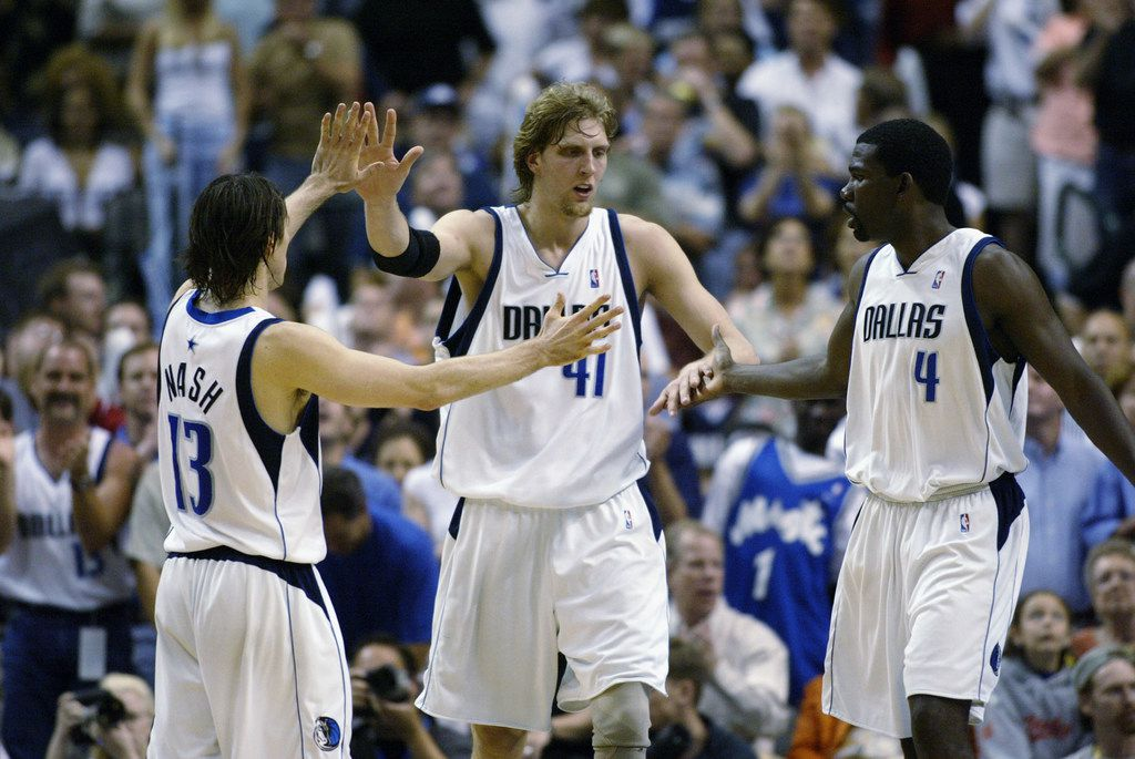 DALLAS - MAY 4:  (Left to Right) Steve Nash #13, Dirk Nowitzki #41, and Michael Finley #4 of the Dallas Mavericks celebrate in Game seven of the Western Conference Quarterfinals against the Portland Trail Blazers during the 2003 NBA Playoffs at American Airlines Center on May 5, 2003 in Dallas, Texas.  (Photo by Ronald Martinez/Getty Images)