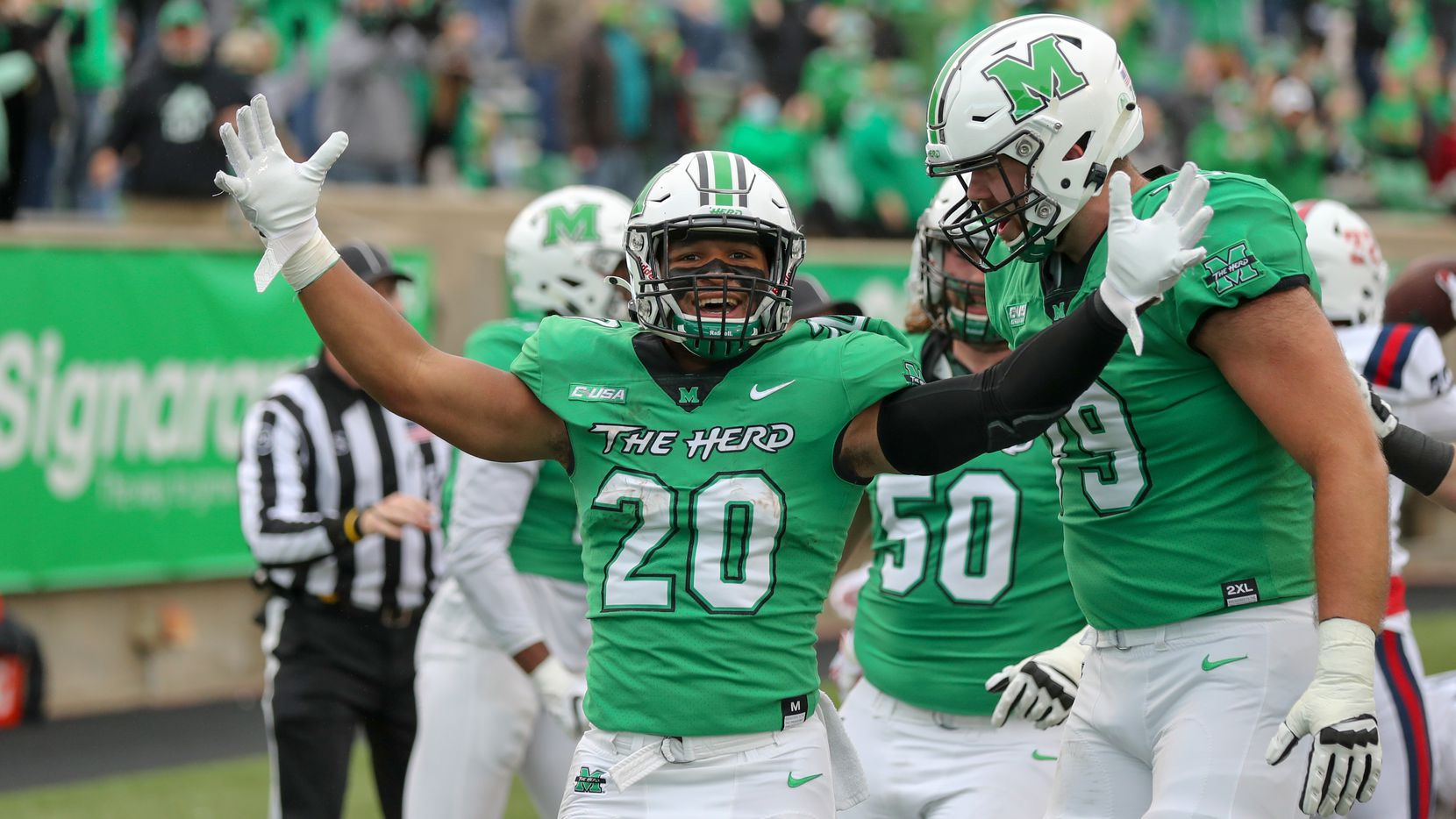 HUNTINGTON, WV - OCTOBER 24: Marshall Thundering Herd running back Brenden Knox (20) celebrates after scoring on a 58-yard pass reception during the first quarter of the college football game between the Florida Atlantic Owls and the Marshall Thundering Herd on October 24, 2020, at Joan C. Edwards Stadium in Huntington, WV.(Photo by Frank Jansky/Icon Sportswire via Getty Images)