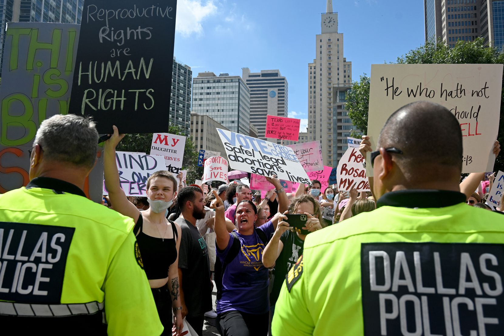 While people on both sides of the abortion issue loudly proclaimed their opinions, Dallas police made sure they stayed apart, and the demonstration remained peaceful.