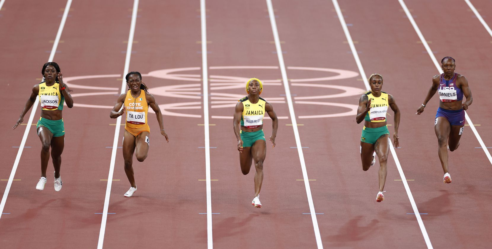 Jamaica's Shericka Jackson, Côte d'Ivoire's Marie-Josée Ta Lou, Jamaica's Shelly-Ann Fraser-Pryce, Jamaica's Elaine Thompson-Herah, and USA's Teahna Daniels compete in the women's 100 meter final race during the postponed 2020 Tokyo Olympics at Olympic Stadium, on Saturday, July 31, 2021, in Tokyo, Japan. Jamaica's Thompson-Herah took gold in the race. (Vernon Bryant/The Dallas Morning News)