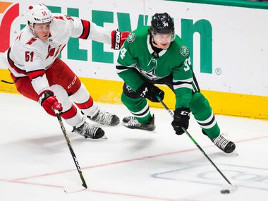 Dallas Stars right wing Denis Gurianov (34) gets ahead of Carolina Hurricanes defenseman Jake Gardiner (51) during the second period of an NHL game between the Dallas Stars and the Carolina Hurricanes on Tuesday, February 11, 2020 at American Airlines Center in Dallas.
