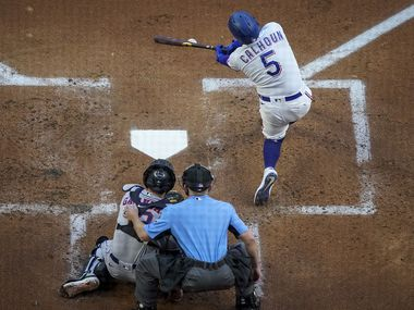 Rangers designated hitter Willie Calhoun bats during the first inning of a game against the Astros at Globe Life Field on Saturday, Sept. 26, 2020.