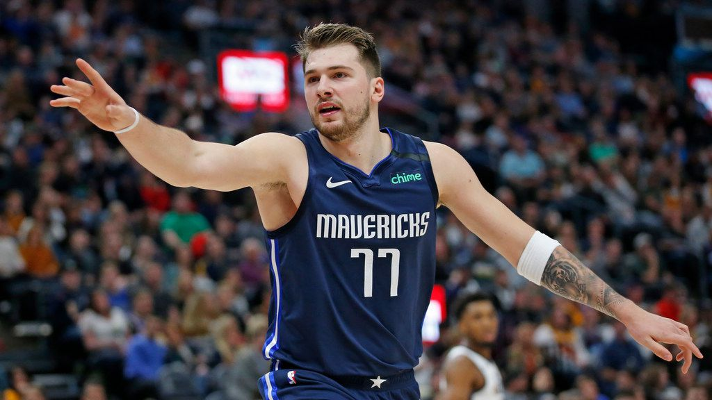 Dallas Mavericks guard Luka Doncic (77) directs his team in the first half during an NBA basketball game against the Utah Jazz Saturday, Jan. 25, 2020, in Salt lake City.