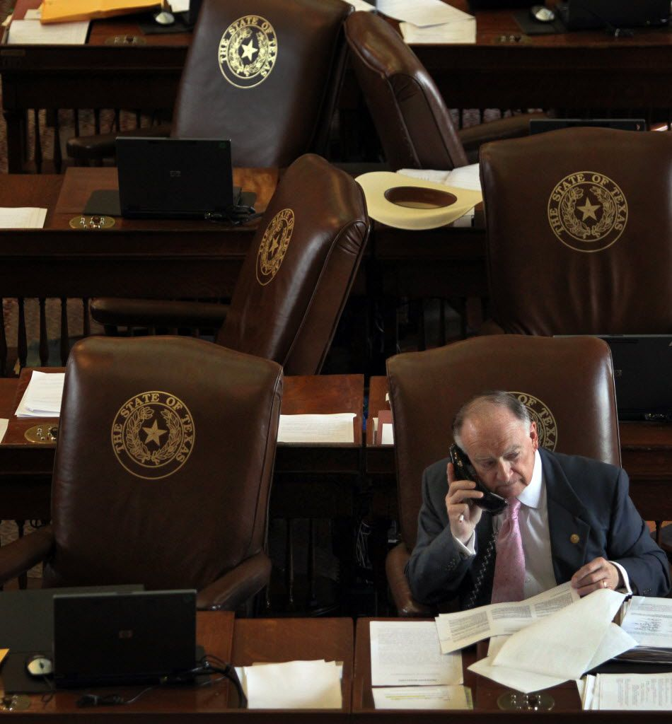 State representative Dan Flynn, R-Canton, works the phones during a break in the Sunday session for the 83rd Texas legislature at the State Capitol in Austin on Sunday, May 26, 2013. (Louis DeLuca/The Dallas Morning News)