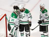 Goaltender Anton Khudobin (35), Jamie Benn (14) and Jason Dickinson (18) of the Dallas Stars celebrate their victory against the Tampa Bay Lightning during Game One of the Stanley Cup Final at Rogers Place in Edmonton, Alberta, Canada on Saturday, September 19, 2020.