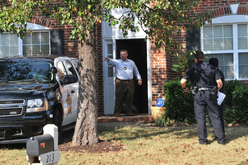"""In this Thursday, Nov. 3, 2016 photo, registered sex offender Todd Christopher Kohlhepp's home is searched by Spartanburg County Sheriff's deputies and his vehicles are impounded in Moore, S.C., after he was arrested earlier in the day. A woman who was """"chained up like a dog"""" for weeks in a dark storage container was lured to her captor's South Carolina property for a cleaning job, a family friend said Friday as search teams digging up the area found one body and looked for more. Kohlhepp, 45, who has a previous kidnapping conviction as a teenager in Arizona, appeared at a bond hearing Friday in Spartanburg on a kidnapping charge. More charges will be filed later, the prosecutor told the court.  (John Byrum/The Spartanburg Herald-Journal via AP)"""